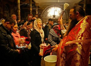 Orthodox priest blesses worshipers